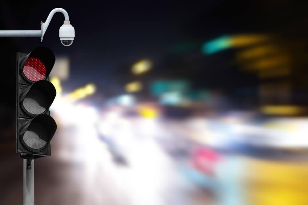 Do Red Light Cameras Make Drivers More Cautious?
